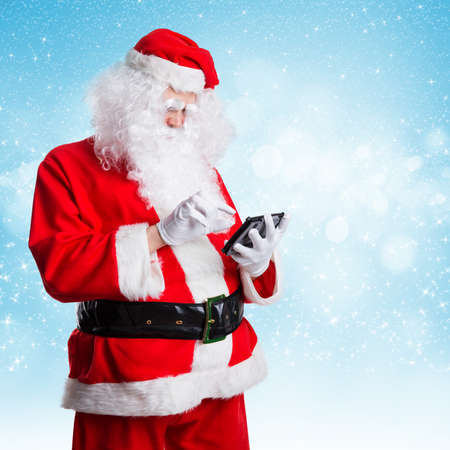 tubby: Santa Claus with a tablet computer in the snow