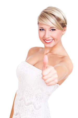 high spirited: attractive blonde young woman with thumb up gesture
