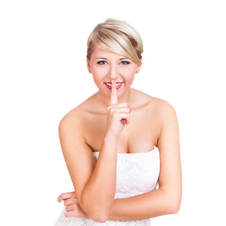 conspiratorial: attractive woman doing sshhh gesture