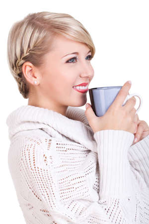 anticipating: attractive young woman in winter clothes with a hot beverage