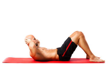 lying on back: muscular man doing sit-ups Stock Photo