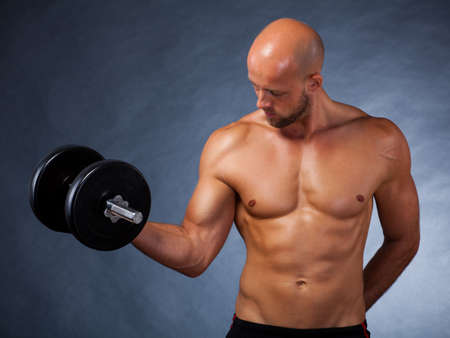 weightlifter: male athlete with dumbbell during a workout