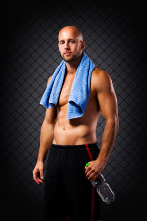 bare chested: athlete after workout with a bottle of water Stock Photo
