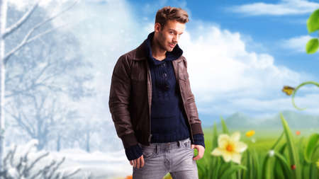 guy standing: handsome guy standing in front a scene symbolizing changing seasons Stock Photo