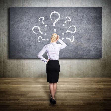 rhetorical: blonde businesswoman thinking about a problem Stock Photo