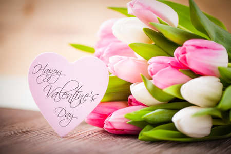 bouquet of tulips and a heart with the message Happy Valentines Day photo