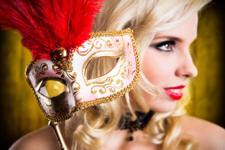 girl in red dress: beautiful woman with golden mask