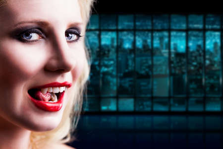 vampire teeth: attractive vampire licking her teeth Stock Photo