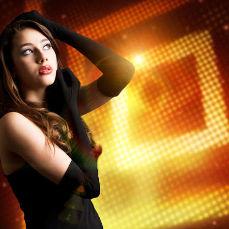 attractive woman in front of light background photo