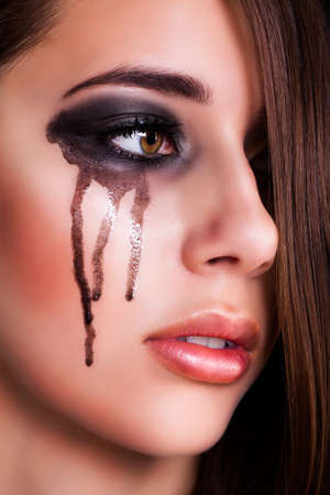 downhearted: crying young woman