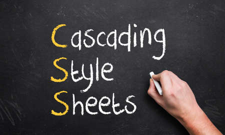 cascading style sheets: hand writing cascading style sheets on a chalk board with the first letters in a different color Stock Photo