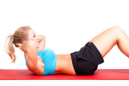 strengthen hand: young sporty woman doing sit-ups