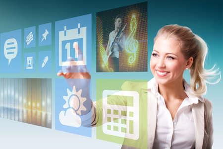 young woman touching a virtual interface Stock Photo