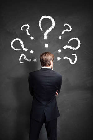 indefinite: businessman trying to solve many questions Stock Photo
