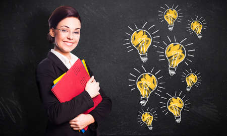 self assured: young businesswoman with many ideas Stock Photo