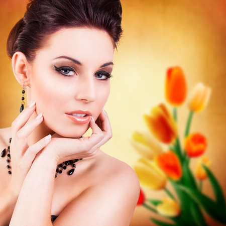 beautiful woman in front of a spring background photo
