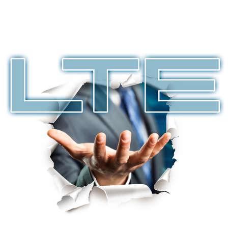lte: hand presenting the acronym LTE Stock Photo