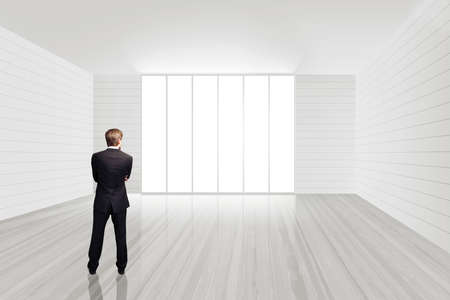 floor standing: businessman standing in an empty office space Stock Photo