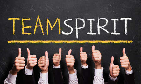 team spirit: many thumbs up to the word team spirit