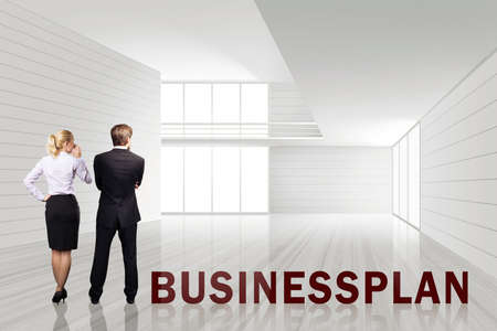 businessplan: businesspeople standing in an empty office space beside the word businessplan