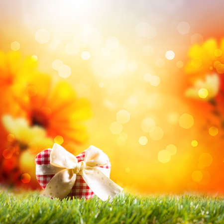 radiant light: fabric heart in front of a spring scene Stock Photo