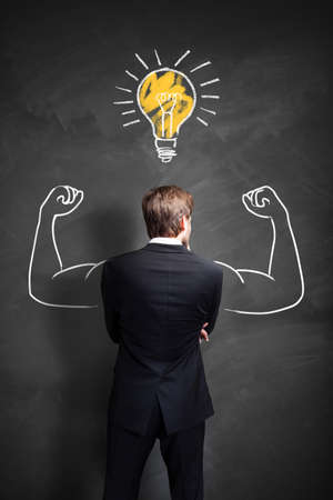 powerful creativity: strong businessman having an idea Stock Photo