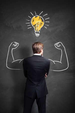 back lighting: strong businessman having an idea Stock Photo