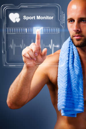 beating: man after workout checking his heart rate on a virtual screen