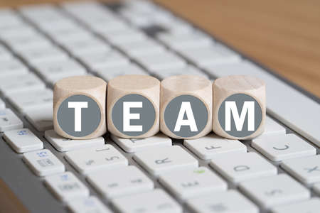 multidisciplinary: little cubes with the word TEAM on a keyboard