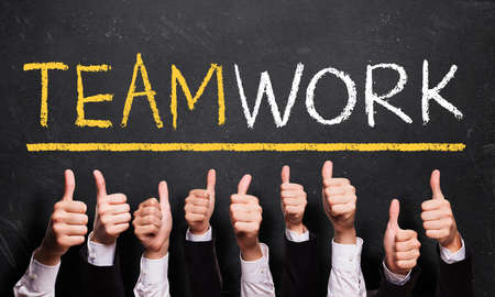 many thumbs up to the word teamwork