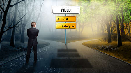 whether: businessman standing at a crossroad having to decide whether to take the risky or the safe way to yield Stock Photo