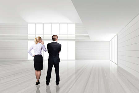 interior designers: businesspeople standing in an empty space