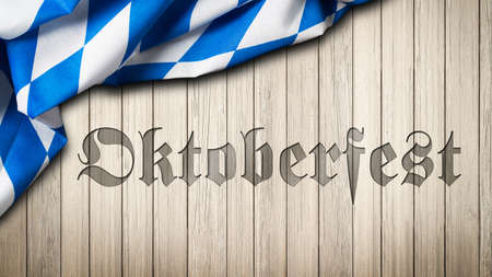Palabra Oktoberfest grabado en madera con mantel bávaro Foto de archivo - 36457257