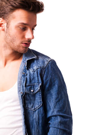 facing right: handsome young man in jeans on isolated