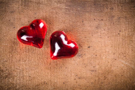 tryst: hearts on wood Stock Photo