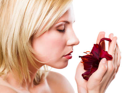 beautiful blonde woman with a flower photo