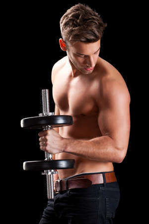 muscular man with a dumbbell during a workout
