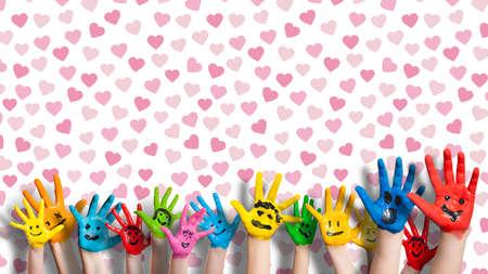 caritas pintadas: manos pintadas de colores Foto de archivo