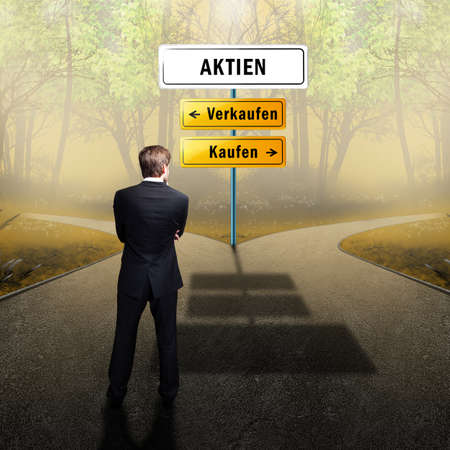 right path: businessman standing on a crossroad, having to choose the right path what to do (with the words shares, sell and buy in German)