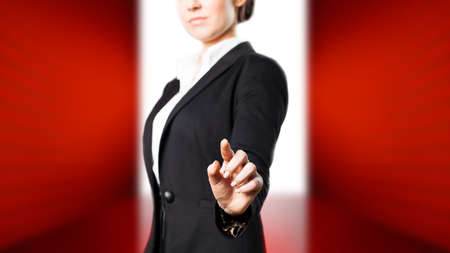 envisage: attractive businesswoman touching a virtual screen Stock Photo