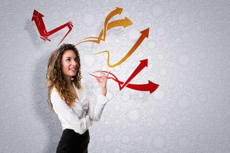 visualizing: attractive businesswoman having many ideas