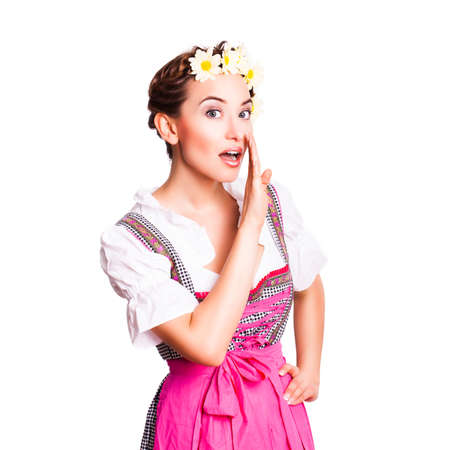 dirndl: beautiful woman in a traditional bavarian dirndl sharing gossip