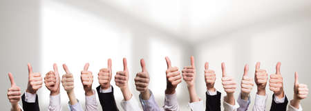 working with hands: many thumbs up Stock Photo