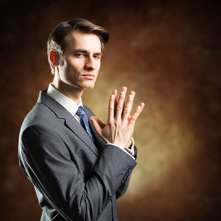 sceptical: businessman looking sceptical Stock Photo