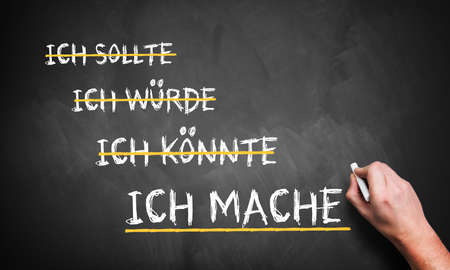 would: hand is writing I should, I could, I would, I do in German Stock Photo
