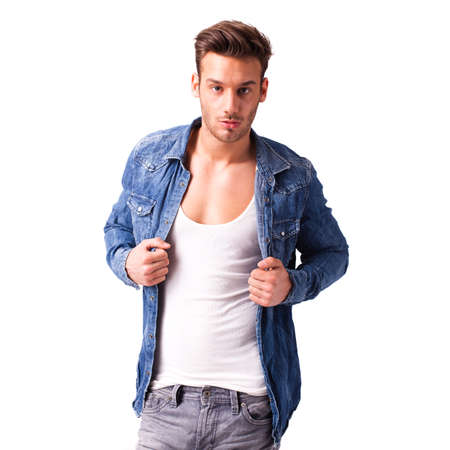 facing right: handsome young man in jeans on isolated background Stock Photo
