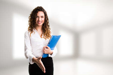 visualizing: attractive businesswoman ready to shake hands Stock Photo