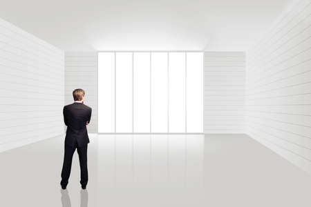 floor standing: businessman in an empty white room