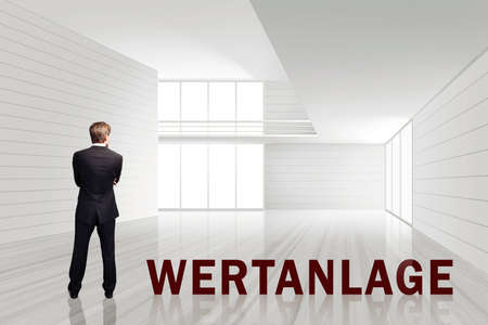 floor standing: businessman in an empty white room with the word Investment in German