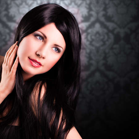 black hair blue eyes: attractive smiling woman Stock Photo
